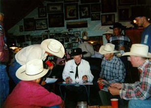 Gerald signing autographs at the rodeo party in 1999.