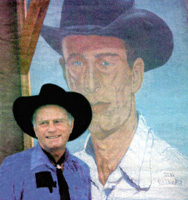 Gerald in front of the Strong City Mural - 1994